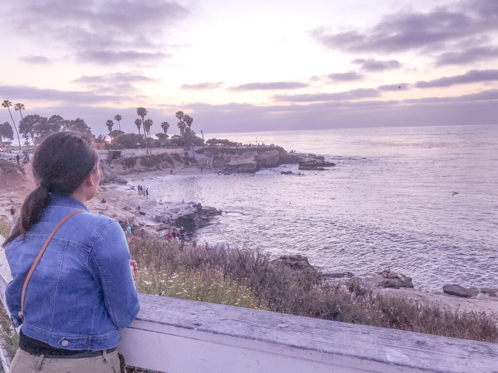 Girl staring out into the beach at La Jolle Cove in San Diego